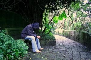 man alone in garden
